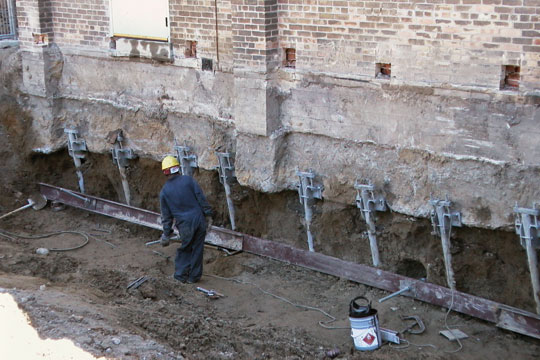 Footing raising stabilization permanently leawood ksking for Pier foundation cost